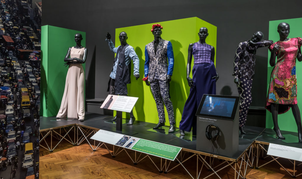 A museum display of six mannequins wearing outfits from Nigerian designers