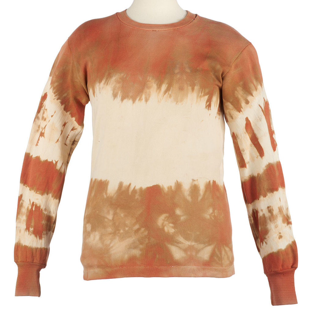 a sweatshirt that has been tie-dyed with ochre.