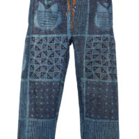 A pair of blue cotton trousers dyed with indigo in geometric patterns