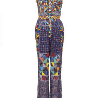 Woman's indigo adire jumpsuit with brightly coloured beaded embellishments