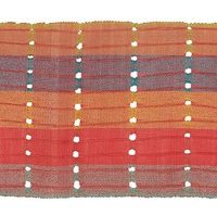 A strip of handwoven aso-oke cloth in stripes of coral, red and purple