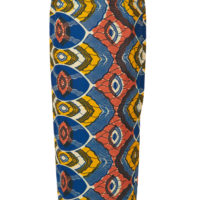 A woman's long pencil skirt made of blue, yellow, white and coral wax print fabric