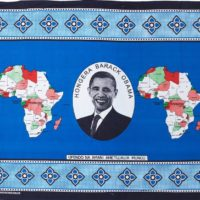 Blue kanga cloth featuring a portrait of Barack Obama and two maps of Africa.