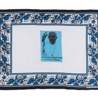 Blue and white kanga with portrait of Pope Francis in the centre