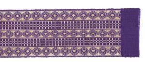 detail of purple aso-oke fabric with diamond and windowpane check designs
