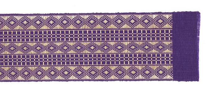 detail of purple aso-oke fabric with diamond and windowpane check designs