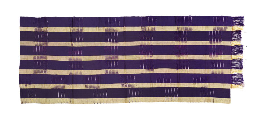 A strip of purple and gold aso-oke fabric