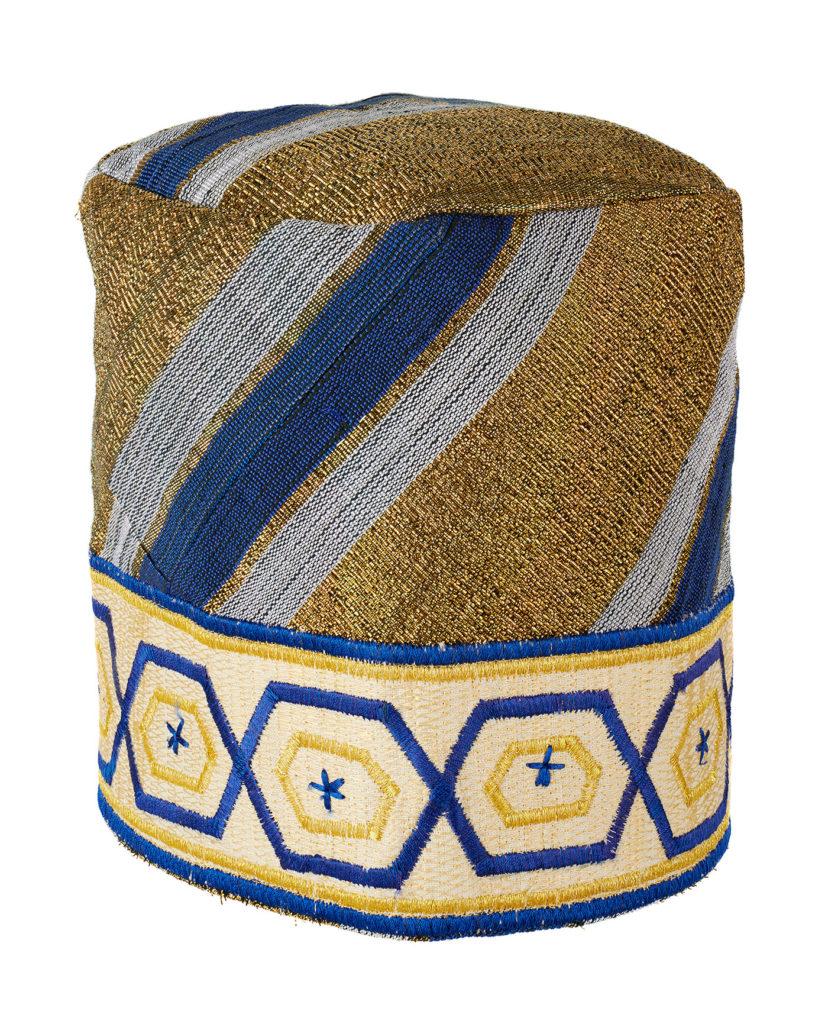 a blue and gold aso-oke cloth cap