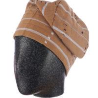 man's beige cloth cap worn on a mannequin head