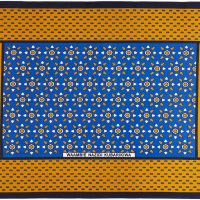 Unseparated pair of kangas in a dark blue, gold, black and white design.