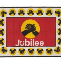 red, white, yellow and black cloth with two clasped hands and the word jubilee