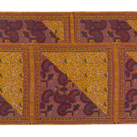 Piece of printed cotton fabric in a purple and orange paisley wax print