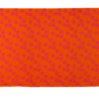 bright orange and pink printed cotton textile