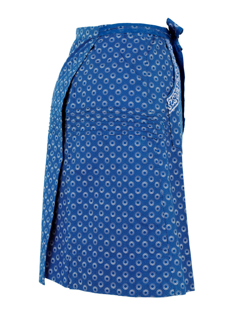 Side view of blue and white shweshwe wrap skirt