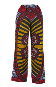 Pair of wax print women's trousers. Olive green and burgundy with a white spiral motif.