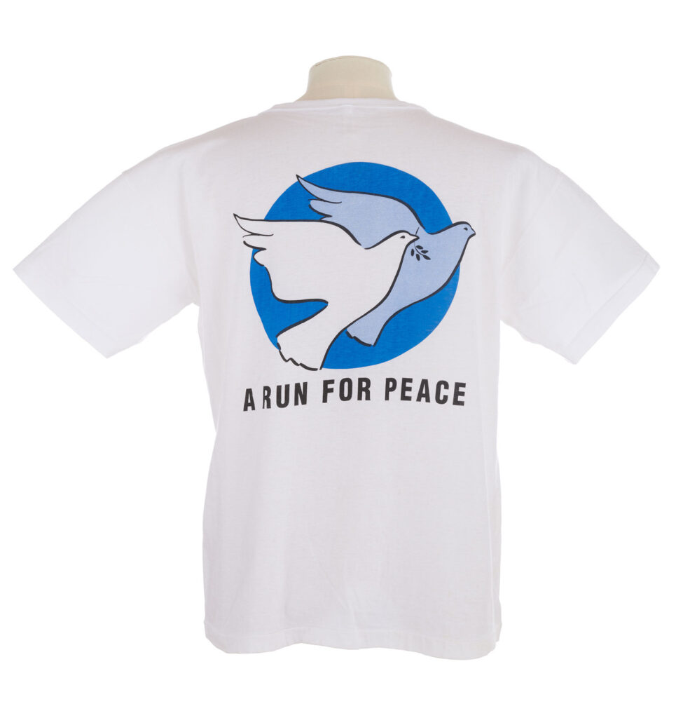 White T shirt with blue doves logo on the back