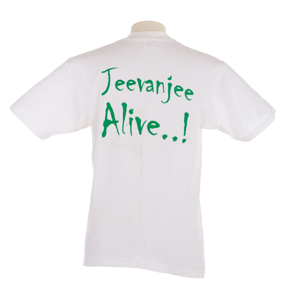 White T shirt with Jevanjee Alive on the back