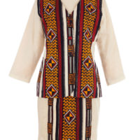 Women's skirt suit, cream fabric base with panels of fabric in maroon, black, yellow and green geometric print and 'kente weave' imitation designs.