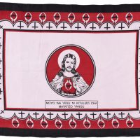 Red, white and black kanga with drawing of Jesus in the centre