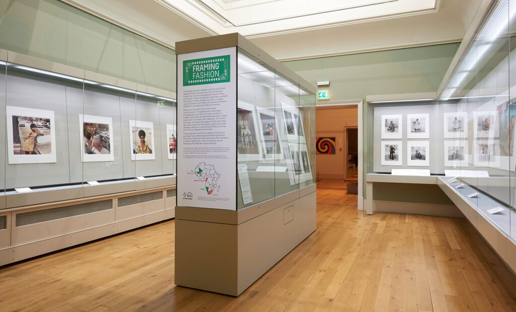 a museum gallery with photographs on display