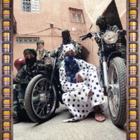 framed art photograph of five morroccan biker women wearing niqabs and kaftans in bold prints