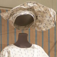 white and silver gele headwrap styled on a mannequin