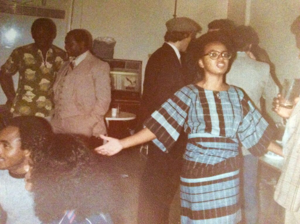 a woman wearing blue aso-oke student party in the 1980s