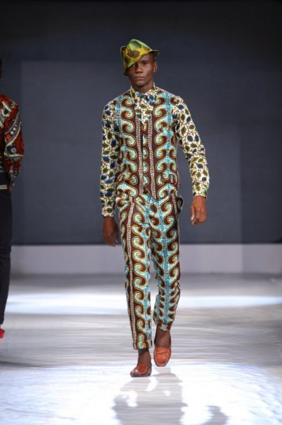 male catwalk model wearing a matching wax print suit and waistcoat