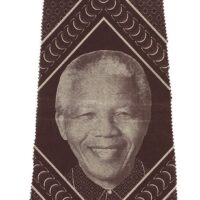 brown and white shweshwe precut skirt panel featuring Nelson Mandela