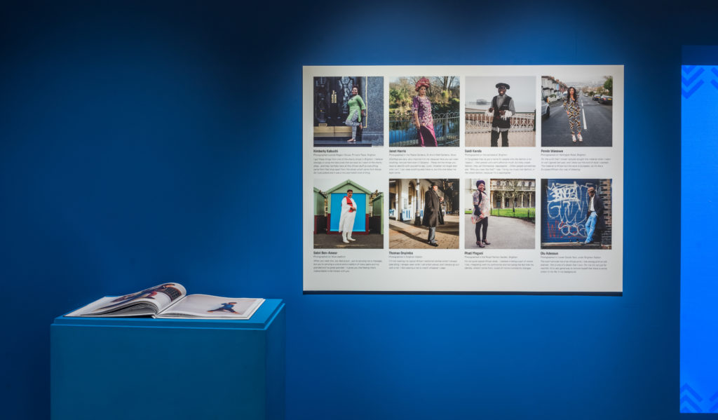 Detail of Brighton Stories display, a panel of photographs of local African diaspora people showing off their outfits on a blue background.