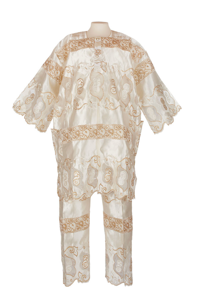 Man's White and gold African lace outfit on mannequin