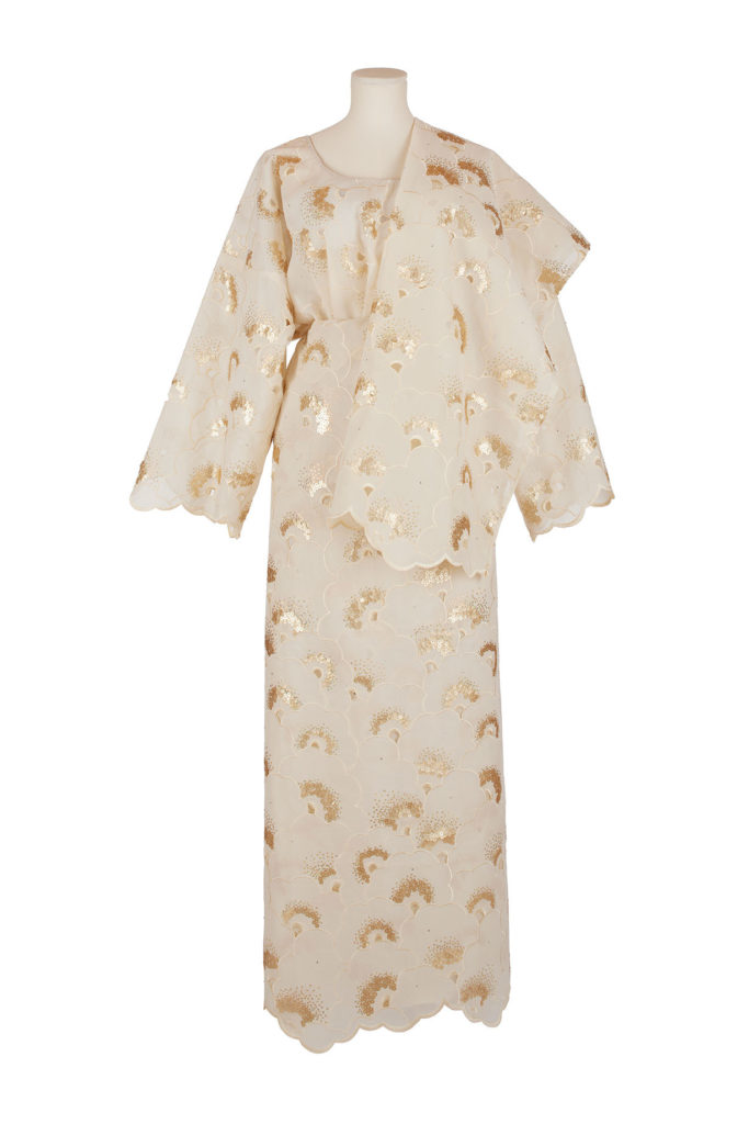 mannequin dressed in white and gold African lace outfit
