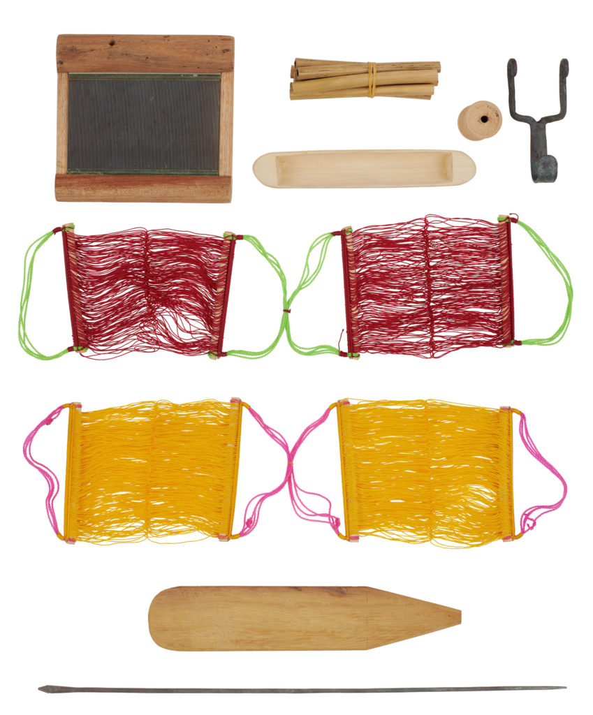 Tools used by a kente weaver