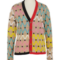 a brightly coloured man's cardigan with zigzag patterns similar to South African beadwork designs