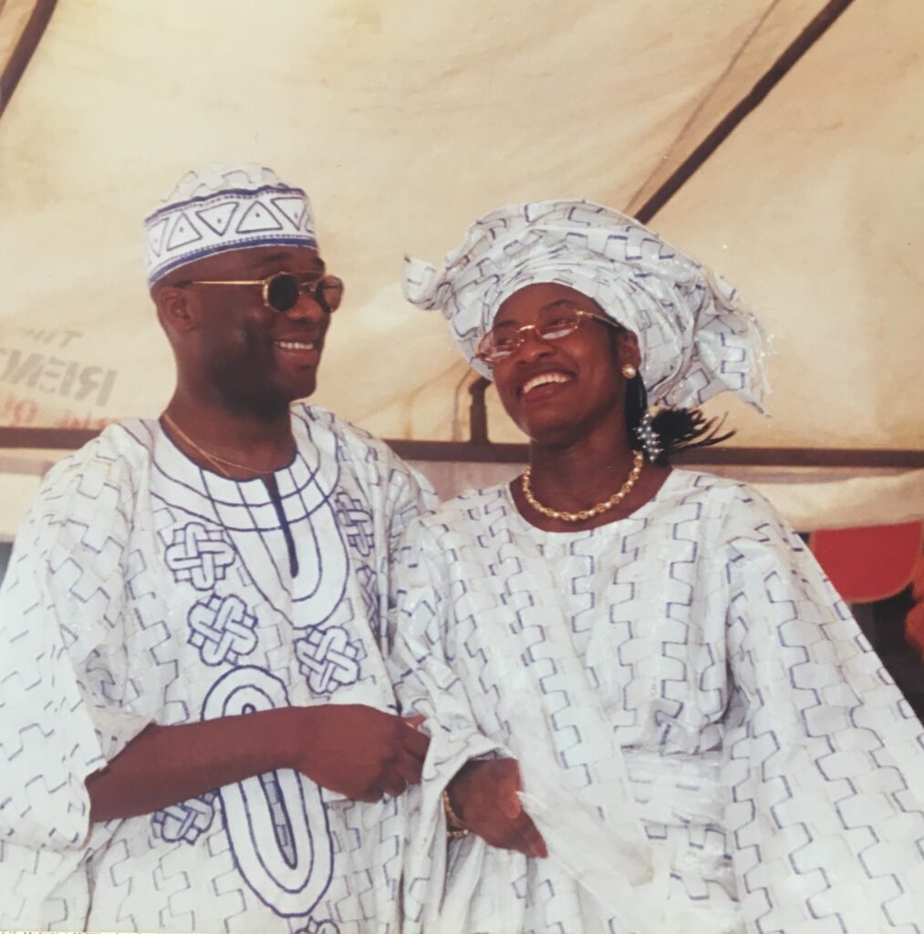 a young yoruba couple wearing white aso-oke at their engagement event