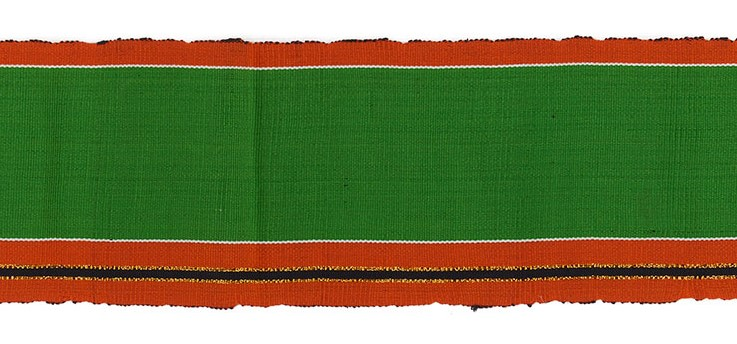 detail of handwoven green and orange striped aso-oke cloth