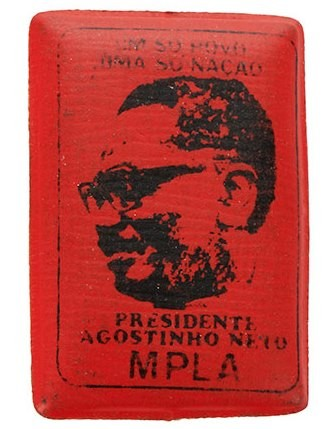 Rectangular red pin badge made of padded plastic featuring Agostinho Neto