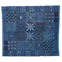 a dark blue cloth with geometric patterns