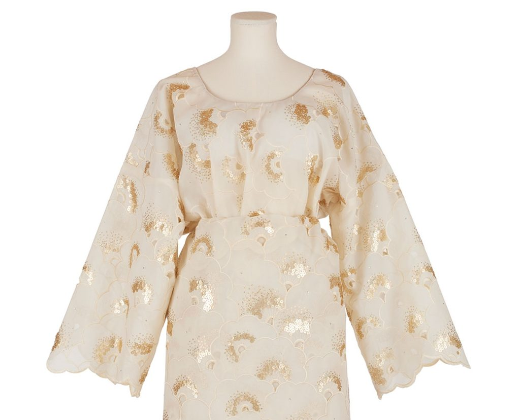 mannequin dressed in white and gold african lace buba blouse