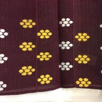 burgundy aso-oke gele with yellow and white floral design