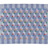 pale blue kente fabric with blocks of small pink, orange, green, white and red squares