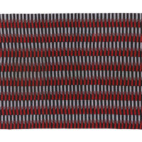 red, black and white woven kente textile