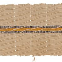 Aso-oke fabric strip. Beige with central vertical stripe of yellow with black and white on either side.