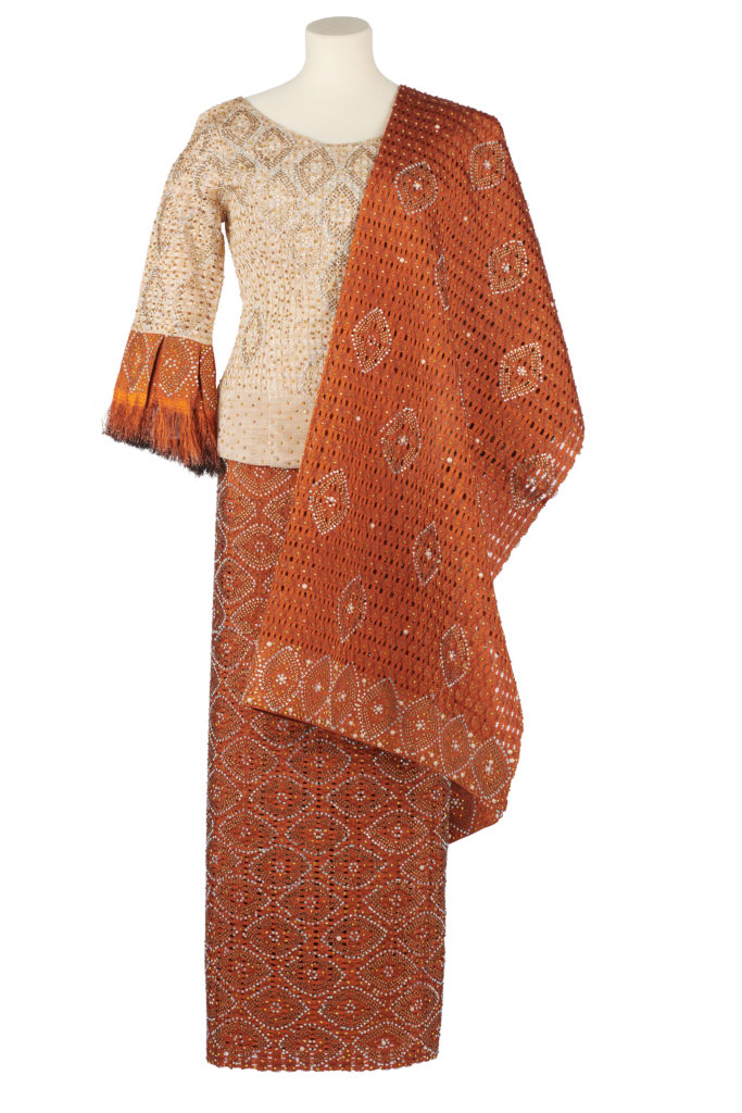 Women's orange and cream aso-oke outfit with sequin and pearl embellishments