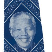 sample of blue and white shweshwe fabric featuring a portrait of Nelson Mandela
