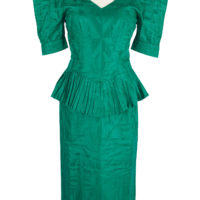 Teal women's blouse and skirt outfit with pointed shoulder pads and pleated peplum waist.
