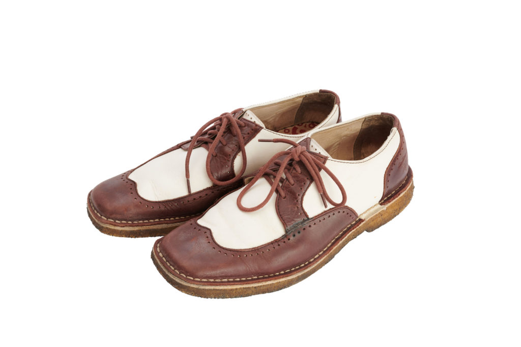 pair of oxblood and white leather men's shoes.