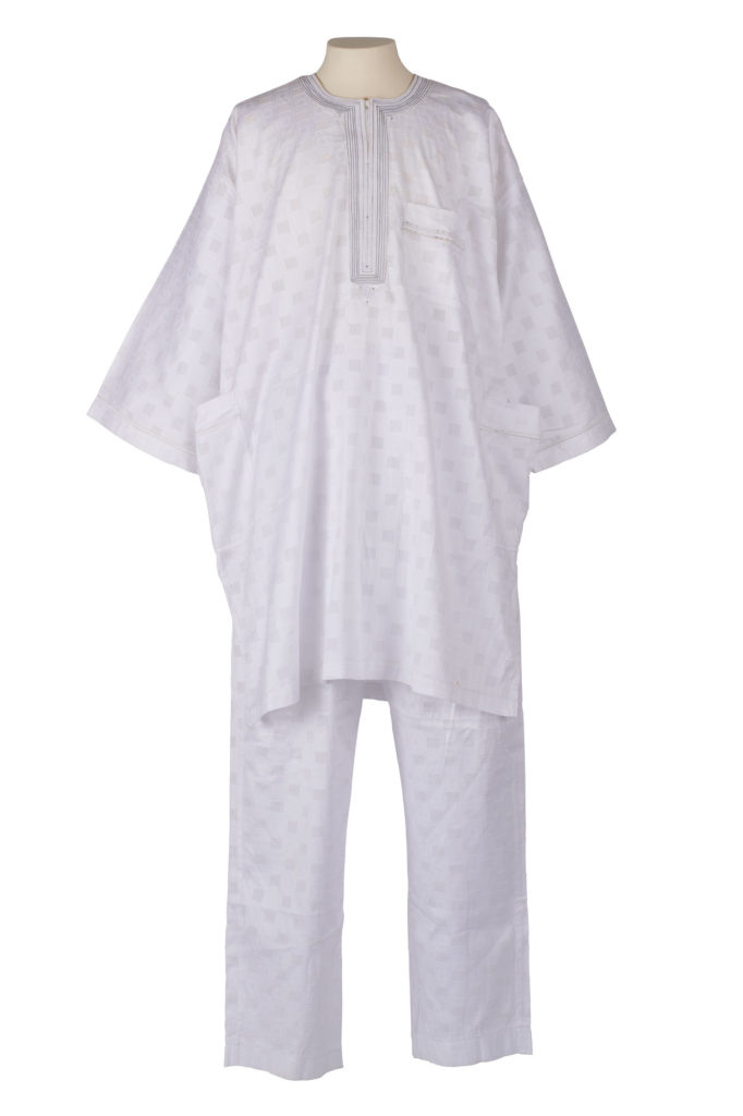 Man's shirt and trousers in a white fabric woven with geometric designs and a silver metallic trim.