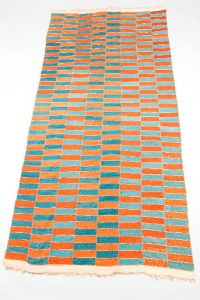 Textile woven with a check design of red, light and dark blue rectangles