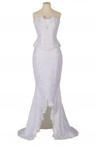 Woman's wedding outfit of white African lace bustier and mermaid skirt
